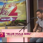"Photo of singer Chase Kauhane singing his song ""Blue Hula Girl"" on Wake Up 2 Day."